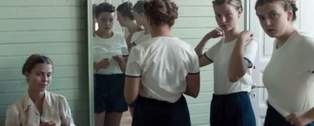 Girls staring in locker room long shot